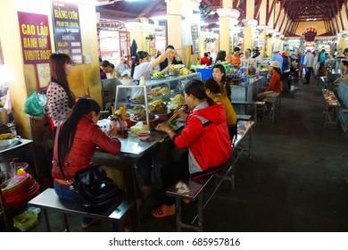 HOI AN, VIETNAM - FEB 3, 2015 - Vietnamese eat lunch at the central market of  Hoi An, Vietnam