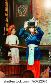 HOI AN, VIETNAM - FEB 3, 2015 - Woman sings traditional Chinese music,  Hoi An, Vietnam