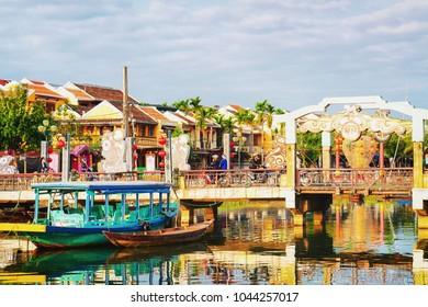 Hoi An, Vietnam - February 17, 2016: Boat at the Embankment of Thu Bon River, Hoi An, Vietnam