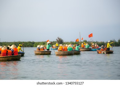 Hoi An, Vietnam - February 24, 2019: Touring the coconut palm forest on the river in bamboo basket boats