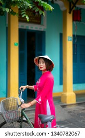Hoi An, Vietnam - February 24, 2019 : Beautiful woman with Vietnam culture traditional dress,vintage style,Vietnam