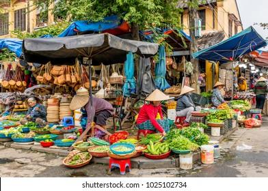 HOI AN, VIETNAM - JANUARY 23, 2018 : Fresh vegetables in traditional street market in Hoi An, Vietnam.