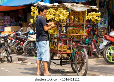 HOI AN, VIETNAM - JANUARY 8, 2010: Typical vietnamese vendor sells bananas on his bicycle at street in Ho Chi Minh