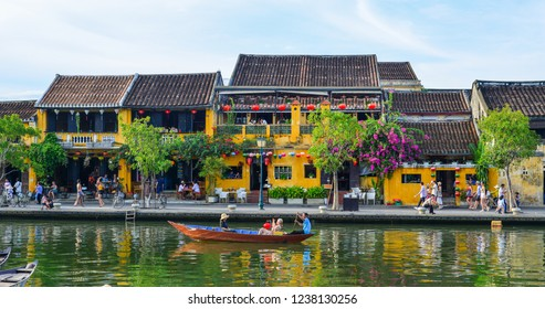 Hoi An, Vietnam - Jul 19, 2018. Old buildings with the river in Hoi An, Vietnam. The historic old town of Hoi An is UNESCO World Heritage Site since 1999.