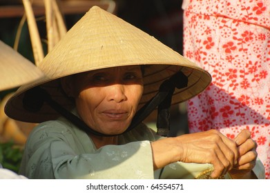 HOI AN, VIETNAM - JULY 12: Unidentified woman takes a rest at the market on July 12, 2010 in Hoi An, Vietnam.