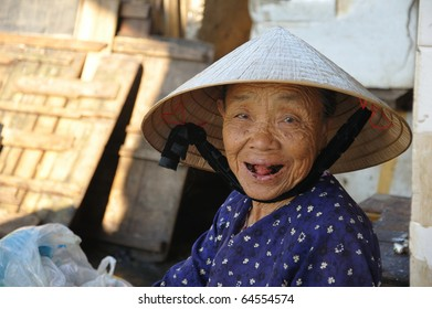 HOI AN, VIETNAM - JULY 12: Unidentified woman gives a great black theethed smile on July 12, 2010 in Hoi An, Vietnam.