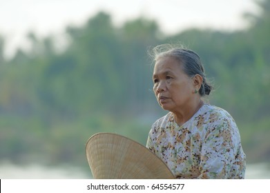HOI AN, VIETNAM - JULY 12: Unidentified woman takes a rest in the early morning sun on July 12, 2010 in Hoi An, Vietnam.