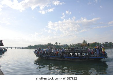 HOI AN, VIETNAM - JULY 12: Hoi An river morning ferry filled to its limit on July 12, 2010 in Hoi An, Vietnam.