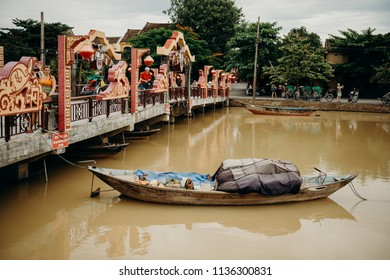Hoi An, Vietnam / Vietnam - July 27 2013: Old Vietnamese boat floating in river at Hoi An