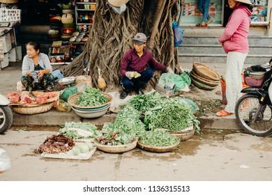 Hoi An, Vietnam / Vietnam - July 27 2013: Vietnamese people selling food at the street