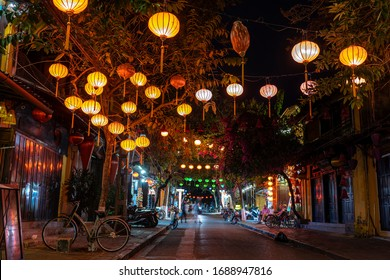 Hoi An, Vietnam - march 15, 2020 : Colorful street and outdoors cafe near river in Hoi An town. Hoi An is city near Da Nang in middle of Vietnam and famous for its well-preserved old town on river