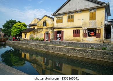 Hoi An, Vietnam - May 19, 2016: Old buildings with the river in Hoi An. Vietnam. The historic old town of Hoi An is UNESCO Heritage Site since 1999.