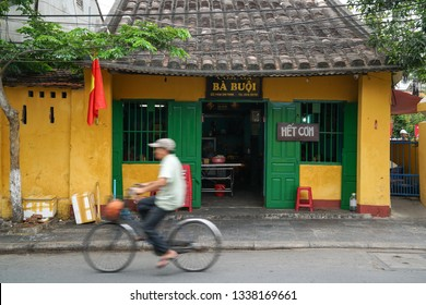 Hoi An, Vietnam - May 19, 2016: Old yellow buildings in Hoi An. Vietnam. The historic old town of Hoi An is UNESCO Heritage Site since 1999.