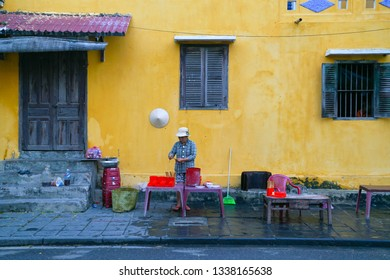 Hoi An, Vietnam - May 22, 2016:  Scene of street vendors with short chairs at Hoi An. The historic old town of Hoi An is UNESCO Heritage Site since 1999.