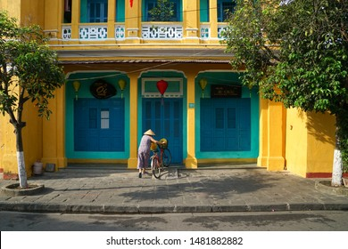Hoi An, Vietnam - May 22, 2016:  Street scene with old heritage buildings at Hoi An, Vietnam. The historic old town of Hoi An is UNESCO Heritage Site since 1999.