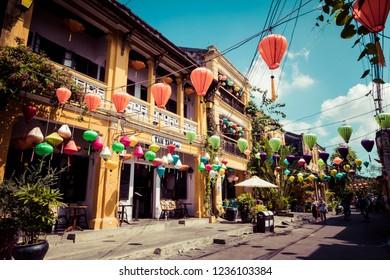 HOI AN, VIETNAM - NOVEMBER 21, 2018: Hoian Ancient town houses. Colourful buildings with festive silk lanterns. UNESCO heritage site. Vietnam.