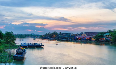 Hoi An, Vietnam - September 04, 2013: People are parking the boats in Thu Bon river