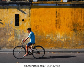 HOI AN, VIETNAM - SEPTEMBER 15, 2017: A man on bicycle in Hoi An.