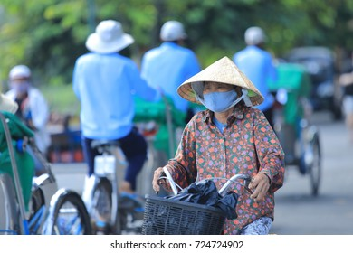 Hoi An, Vietnam - September 4, 2017.  An everyday street scene in the Old Town of Hoi An, Vietnam.  Here, traditional daily life mixes with tourists coming to enjoy the food, culture and architecture.