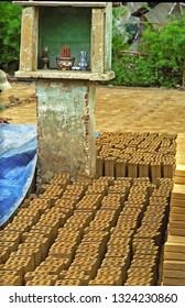 Hoi An, Vietnam,  small altar for Buddha in the city bricks furnace.
