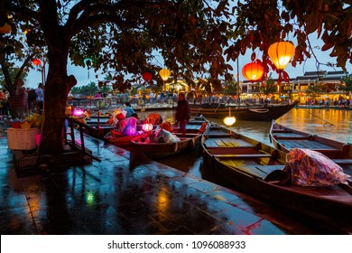 Hoi An, Vietnam. Street view with traditional boats on a background of ancient town.