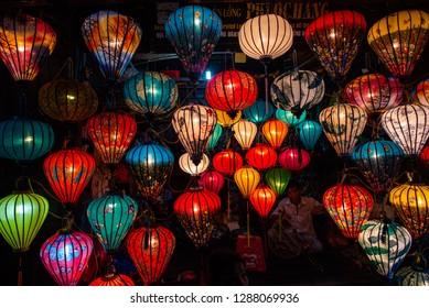 Hoi An, Vietnam-December 11, 2018: A worker is crafting with silk Vietnamese lantern in a local tourist attraction shop in Hoi An, Vietnam.