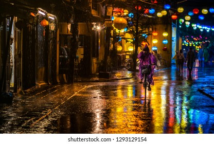 Hoi An, Vietnam-December 11, 2018: Tourism in rainy season on a famous walking street in Hoi An, Vietnam.