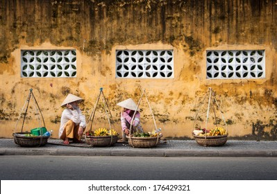 HOI AN, VIETNAM-DECEMBER 7: local Vietnamese women street vendor in Hoi An on December 7, 2011 in Hoi An, Vietnam. Hoi An is the renown of World heritage cultural site.