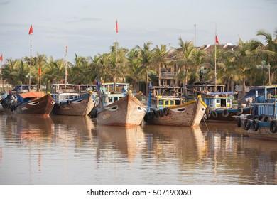 Hoi An, Vietnam-October 20, 2009. Fishing boats on the Song Thu Bon River, Hoi An, Vietnam, on the  South China Sea coastline.