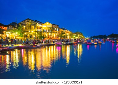 Hoi An ancient town by Thu Bon River in Vietnam at night