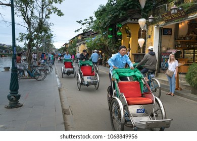 Hoi An ancient town, Vietnam - January 10, 2018: The cyclos in Hoi An. Travelers enjoy when moving by cyclo in Hoi An