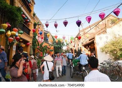 HOI AN,VIETNAM - August 12,2017 : Crowded of tourists visit the ancient village during the holiday.