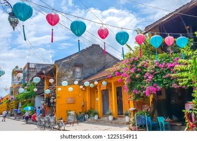 Hoi An/Vietnam - July, 2018: Tourists are visiting the old yellow houses of the ancient Hoi An Town, Vietnam.