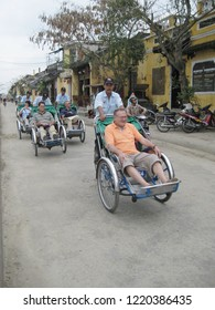 Hoi An,Vietnam-Circa October 2011: Group of elder European tourists takes the traditional Vietnam's Cyclo that is three wheels cycling taxi to go around for sightseeing.