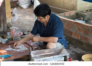 Hoi An Kim Bong Village, Quang Nam, Vietnam - 12/5/2018:  A craftsman busy with the art of shell inlay into wood. The art has been practiced in Vietnam for centuries.