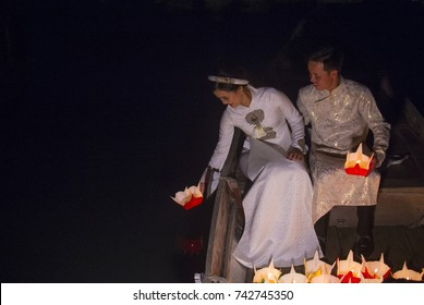 HOI AN , VIETNAM - OCT 04 : Vietnamese couple dropping Lantern into the River in Hoi An ,Vietnam during the Hoi An Full Moon Lantern Festival on October 04 2017