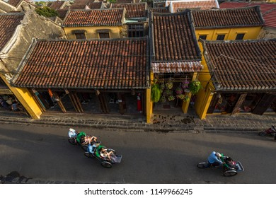 HoiAn City, QuangNam province/ VietNam- 10/25/2017:  Cyclo tourists take a walk around the old town of Hoi An city, from above
