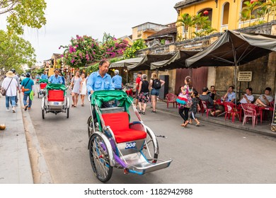 HOIAN,VIETNAM-JULY 21,2018: Traditional bicycle.(cyclo) waiting for tourists to visit the ancient city .Here is a UNESCO World Heritage Site.
