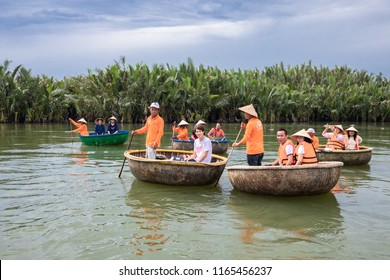 HOIAN,VIETNAM-JULY 22,2018: Tourists enjoy round basket boat Made of bamboo is a unique Vietnamese at Cam thanh village