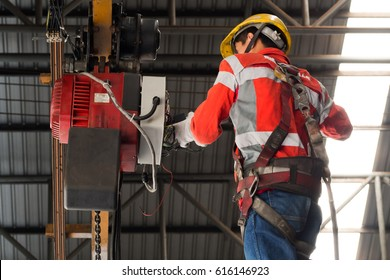 Hoist maintenance by technician