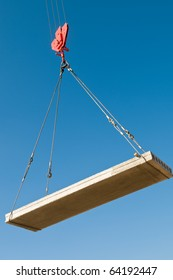 hoisting a concrete slab with crane using metal slings