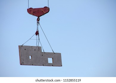 Hoisting construction works with tower crane during erection multistory building
