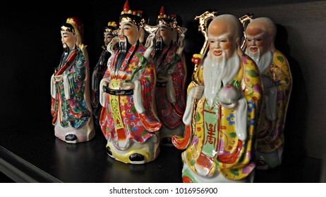 Hok Lok Siew are God of fortune, longevity & happiness. Beautiful ceramic Chinese Gods for Chinese new year background or wallpaper.