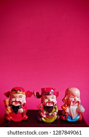 Hok Lok Siew are God of fortune, longevity & happiness. Beautiful ceramic Chinese Gods on red background. Chinese new year festive background or wallpaper.