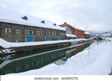 Hokkaido, Japan - 9 February 2014 : View of Otaru Canal in winter, Otaru Canal where the popular place with beautiful and classic scenery of the canal lined by old warehouses.