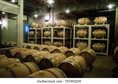 Hokkaido, Japan- 9 NOV 2015: Wooden barrels use to store Japanese wine produced in wineries on Furano, Hokkaido. Furano Winery is open to the public and includes free wine tasting.