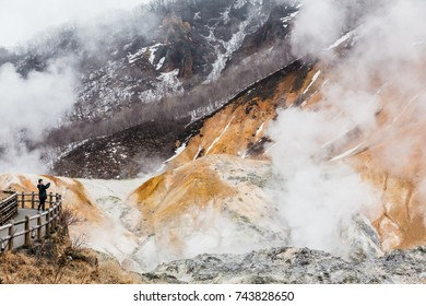 HOKKAIDO, JAPAN. APRIL 2, 2016: Tourist take photo of Noboribetsu Jigokudani (Hell Valley): The volcano valley with sulfuric smell in Hokkaido, Japan.