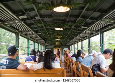 Hokkaido Japan : August 18 2018 :The tourists and ๋Japanese Peple Interior of a local train in Hokkaido.