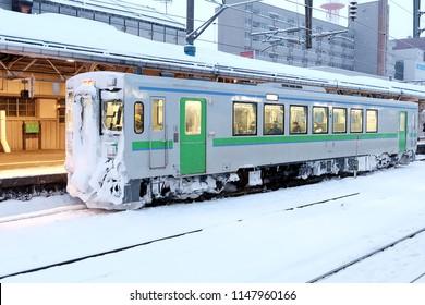 HOKKAIDO, JAPAN: August 2, 2018: Local train at Hokkaido, Japan In the winter, we will see snow full of snow. Snow is a lump in front of the train, the Hokkaido Railway Company (JR Hokkaido) for Hakod