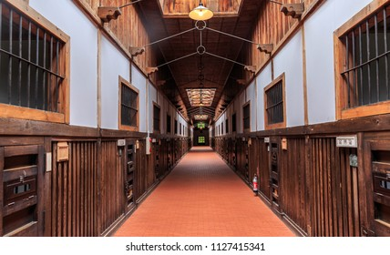 Hokkaido, Japan - August 3, 2017: Restored corridor with wooden cells at Abashiri Prision, originally opened in 1890 and housed over 1,000 political prisoners during the Meiji Era